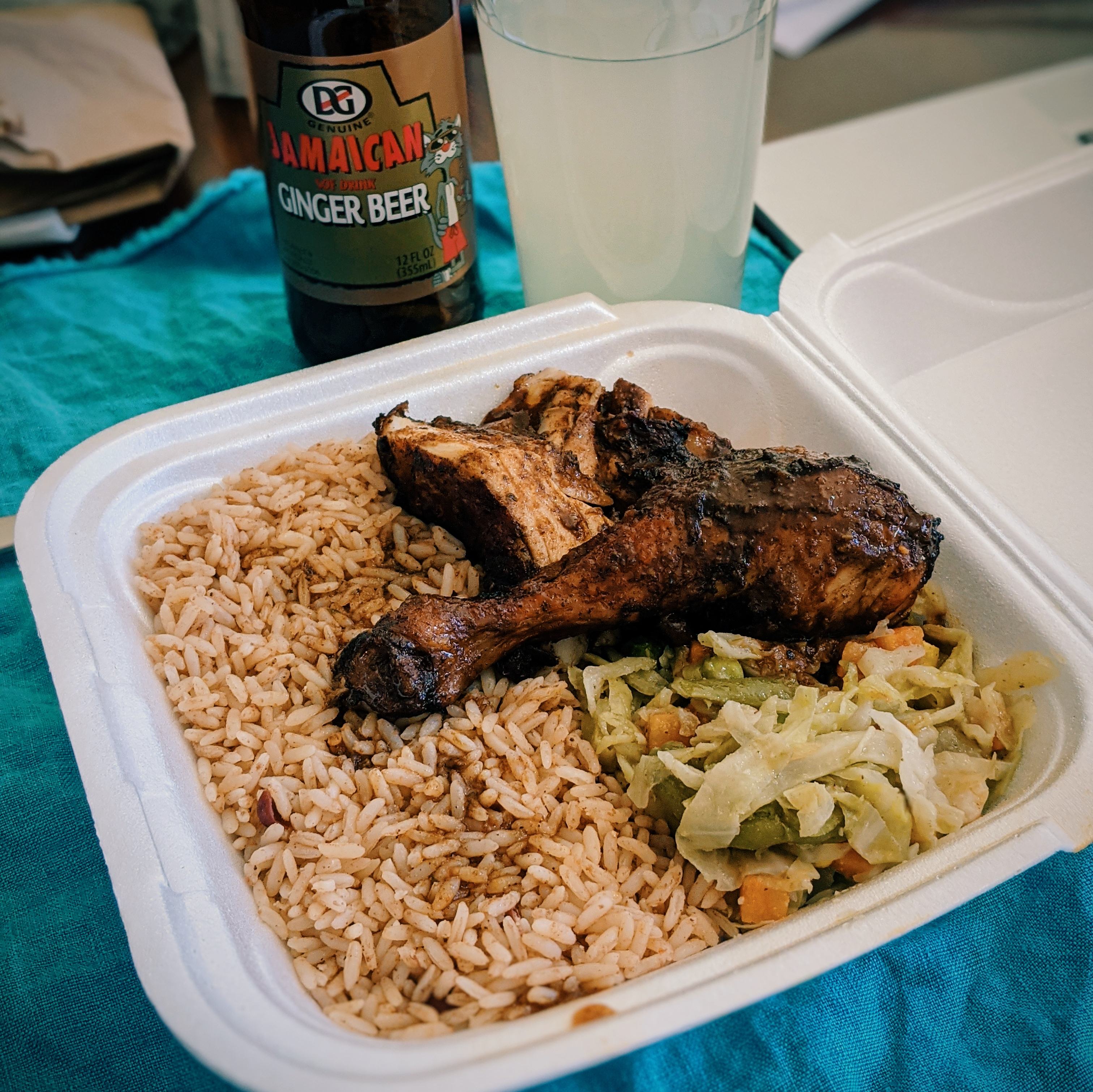 Jerk chicken and rice in takeout container